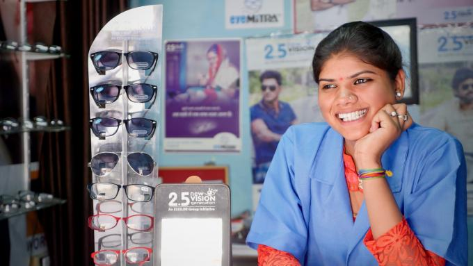 A smiling woman in an Indian optics shop