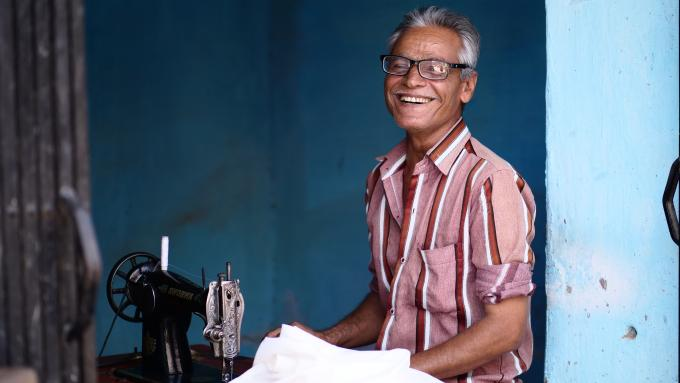 Textile worker with new glasses smiling