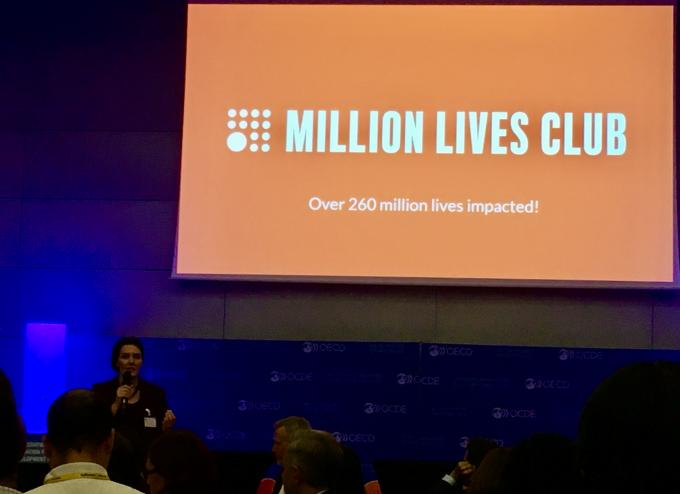 Alexis Bonnell speaking at Million Lives Club event