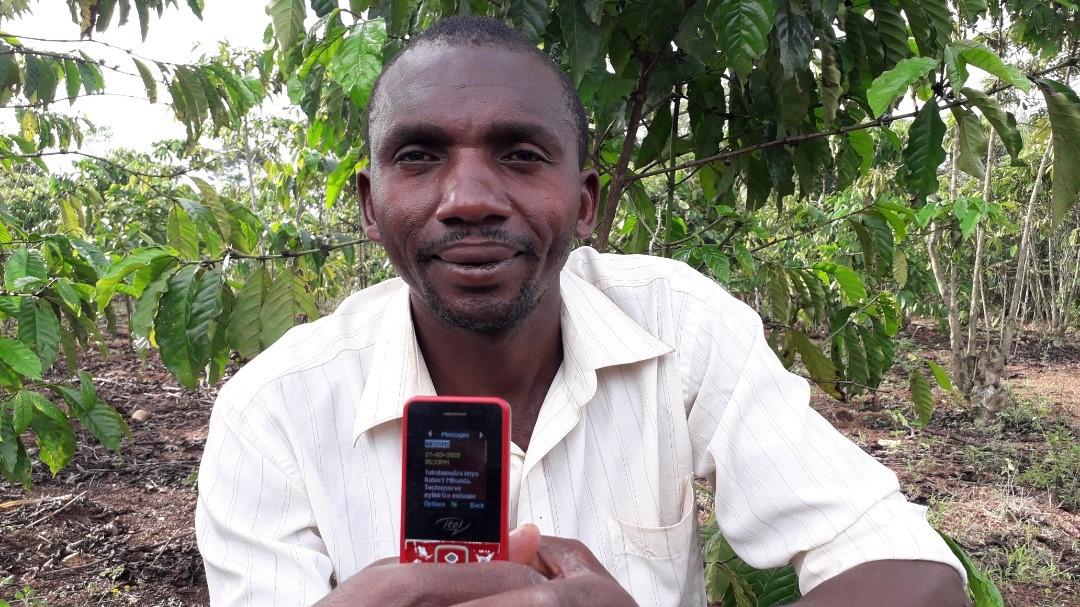 Robert Mihanda shows off a text message he received