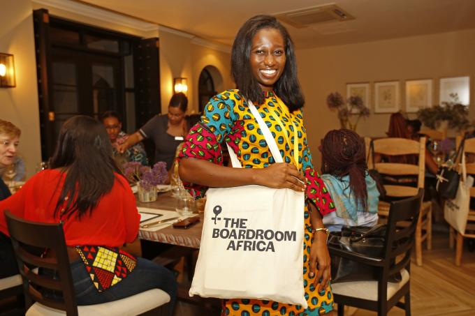 A woman with a bag of TheBoardroom Africa