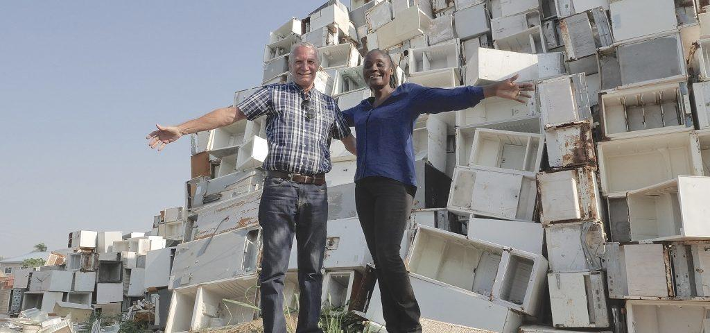 Founders of the City Waste Group in front of fridges that that will be dismantled. Copyright: City Waste Group