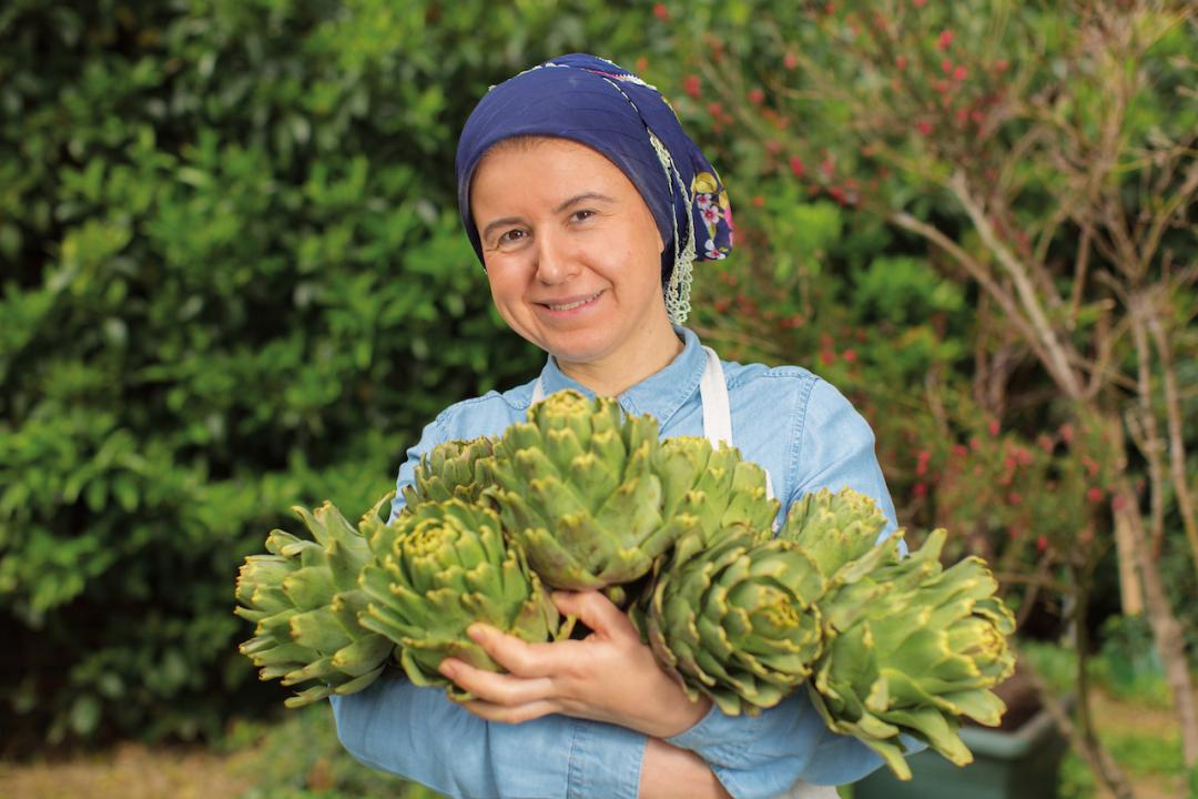 Cover image for BigChefs, woman holding produce (artichokes?)