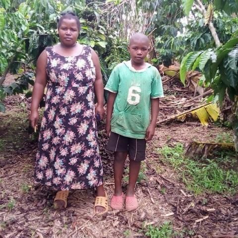 Farmer Ovia Biringwa with her son on the farm