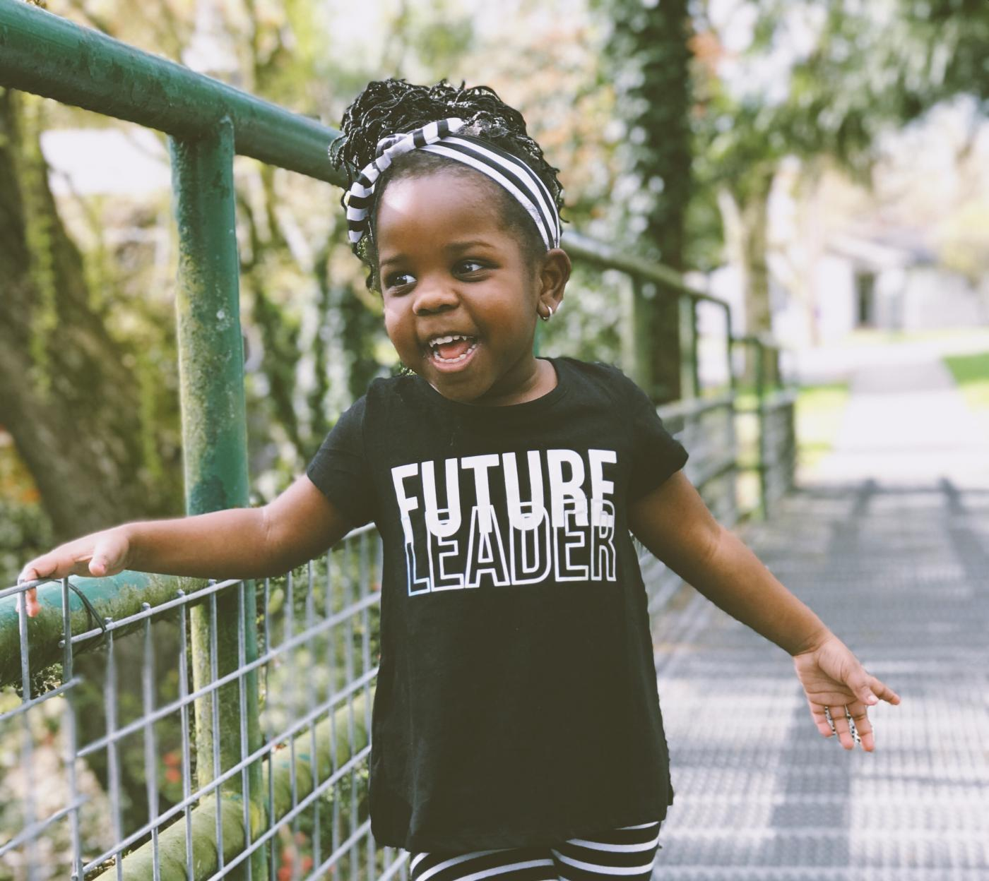 Girl on a bridge wearing a future leader shirt