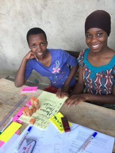 Tanzanian girls listing their family's priorities in health spending
