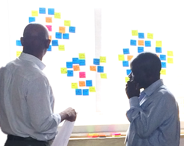An innovator team mapping their strategy to scale during an Xcelerator workshop